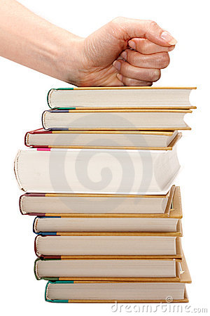 Feminine fist on pile of the books