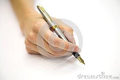 Feminine hand with pen