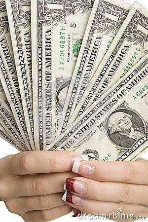Feminine hands holding money