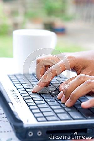 Feminine hands on laptop