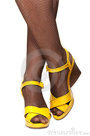 Feminine legs, yellow sandals