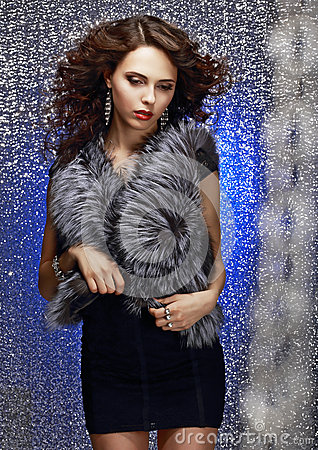 Femininity and Sensuality. Gorgeous Sophisticated Lady in Fur Vest