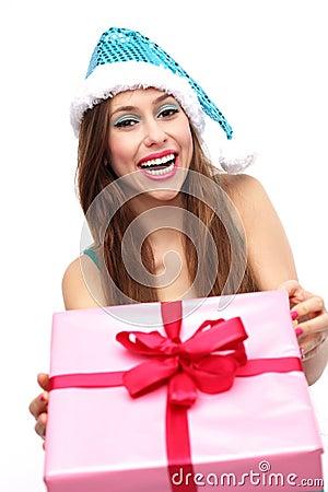 Femme dans cligner de l oeil de chapeau de Noël