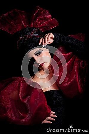 Femme fatale in a red-black dress