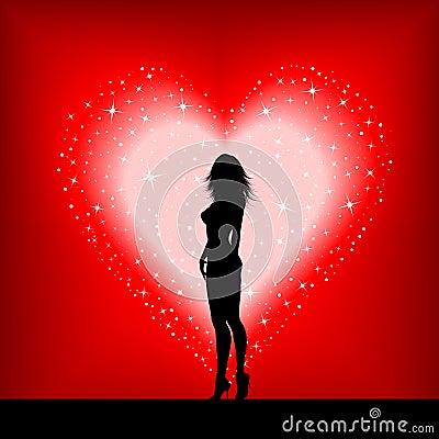Femmina sexy su un cuore stellato