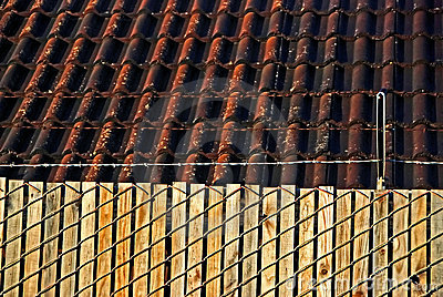 Fence, barb wires and roof