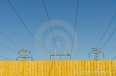 Fence with blue sky and power lines