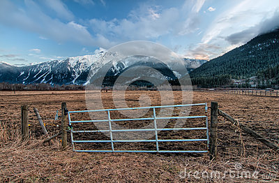 Fence Gate with Snowy Mountains