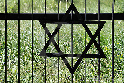 Fence in old jewish cemetery in Ozarow. Poland