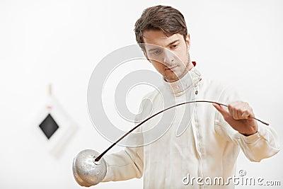 Fencer checking rapier foil