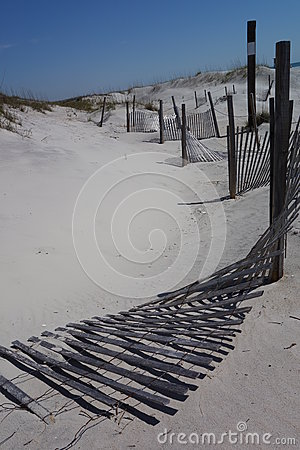 Fences on white sandy beach