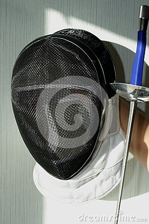 Fencing Helmet And Fencing Sword Stock Photo - Image: 58063243