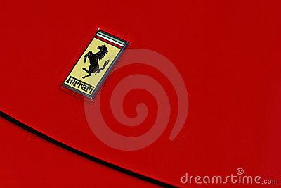 Ferrari logo on red sport car Editorial Stock Photo