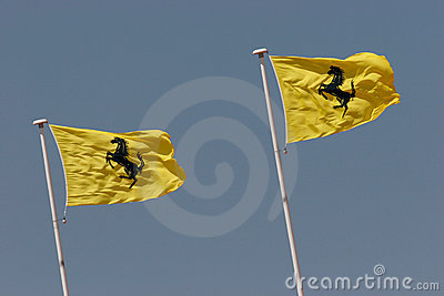 Ferrari logo on yellow flag Editorial Stock Image
