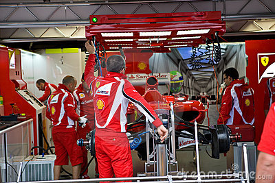 Ferrari Team Preparing Felipe Massa's car Editorial Photo