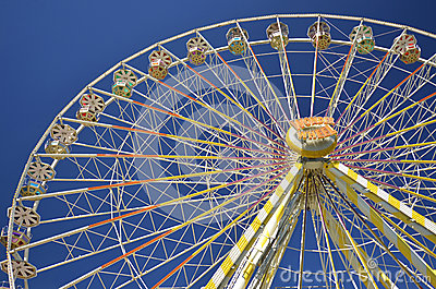 Ferris wheel against blue sky Editorial Photography