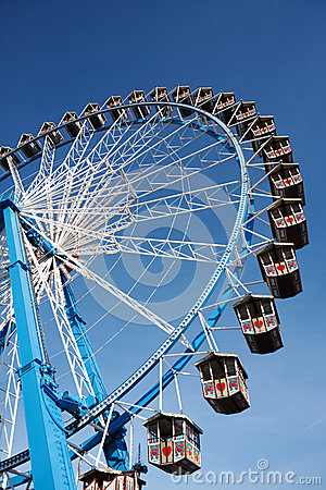 Ferris wheel against clear blue sky