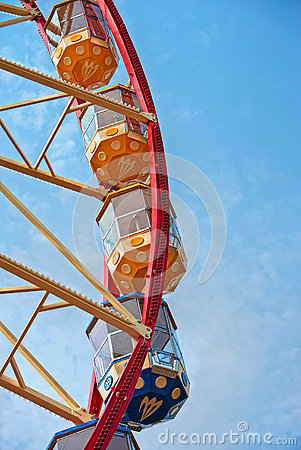 Ferris wheel on the blue sky