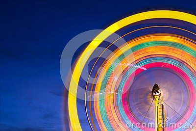 Ferris wheel with motion blurred lights