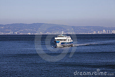 Ferry boat on bay heading towards viewer