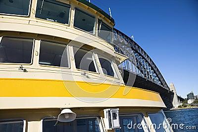Ferry by bridge.