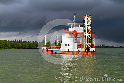 Ferry on the river before storm
