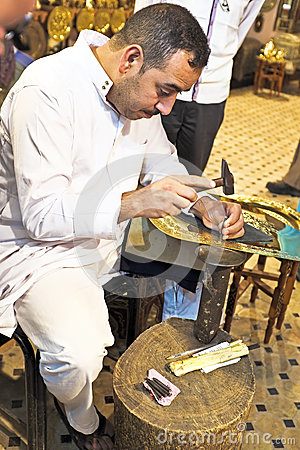 FES, MOROCCO - OCTOBER 17, 2013: Man making antique arabic handi Editorial Image