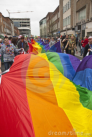 Festival goers hold the rainbow banner Editorial Image
