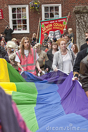 Festival goers hold the rainbow banner Editorial Photo