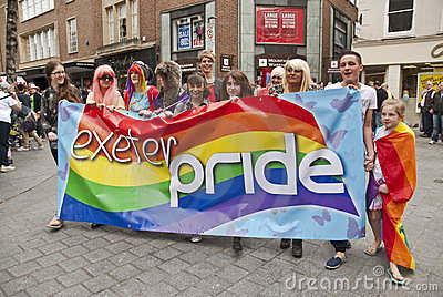 Festival goers hold up the Exeter Pride banner Editorial Image