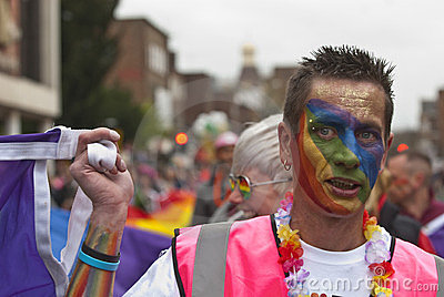 Festival goers with a painted face at Exeter Pride Editorial Photography