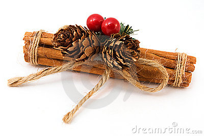 Festive Cinnamon stick decoation over white