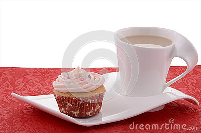 Festive cupcake with tea on fancy plate