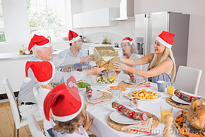 Festive family exchanging gifts