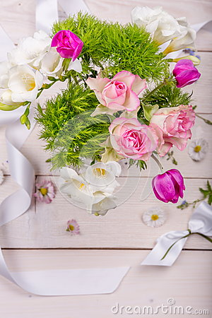 Free Festive Flower Composition On The White Wooden Background. Overhead View. Stock Image - 94315411