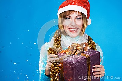 Festive girl with Christmas gift