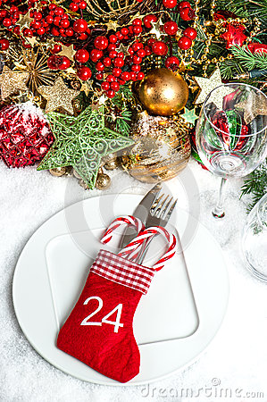 Festive table setting with christmas tree decoration