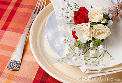 Festive table setting with flowers and vintage crockery