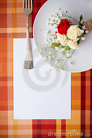 Festive table setting with flowers and vintage crockery, card te