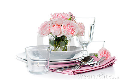 Festive table setting with pink roses