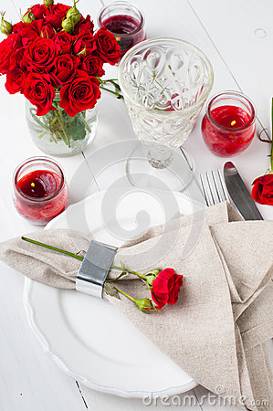 Festive table setting with red roses