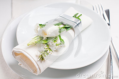 Festive table setting in white