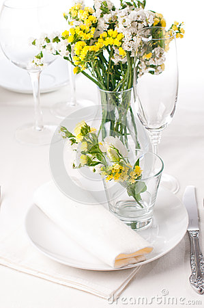 Festive table setting in yellow