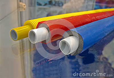 Few color plastic cables on glass surface,