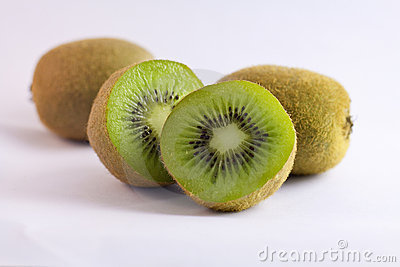 A few kiwi fruits isolated on white