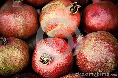 Few red mellow pomegranates in range.