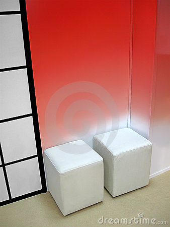 Few white seat, red wall, interior,