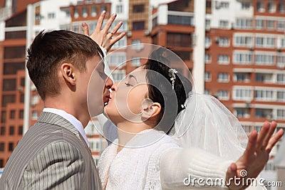 Fiance kisses bride outdoor