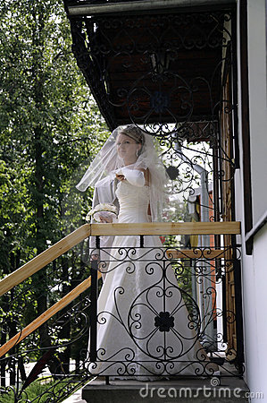 Fiancee on the porch of the house