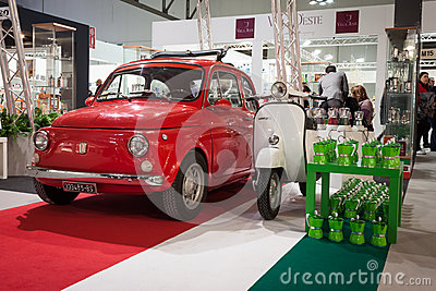 Fiat 500 car and Vespa scooter on display at HOMI, home international show in Milan, Italy Editorial Photo